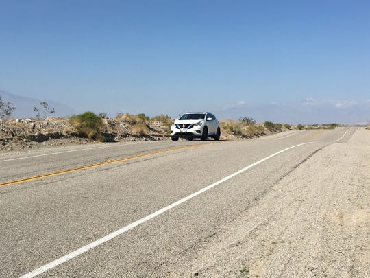 An SUV heads east on Dillon Road in the Indio Hills