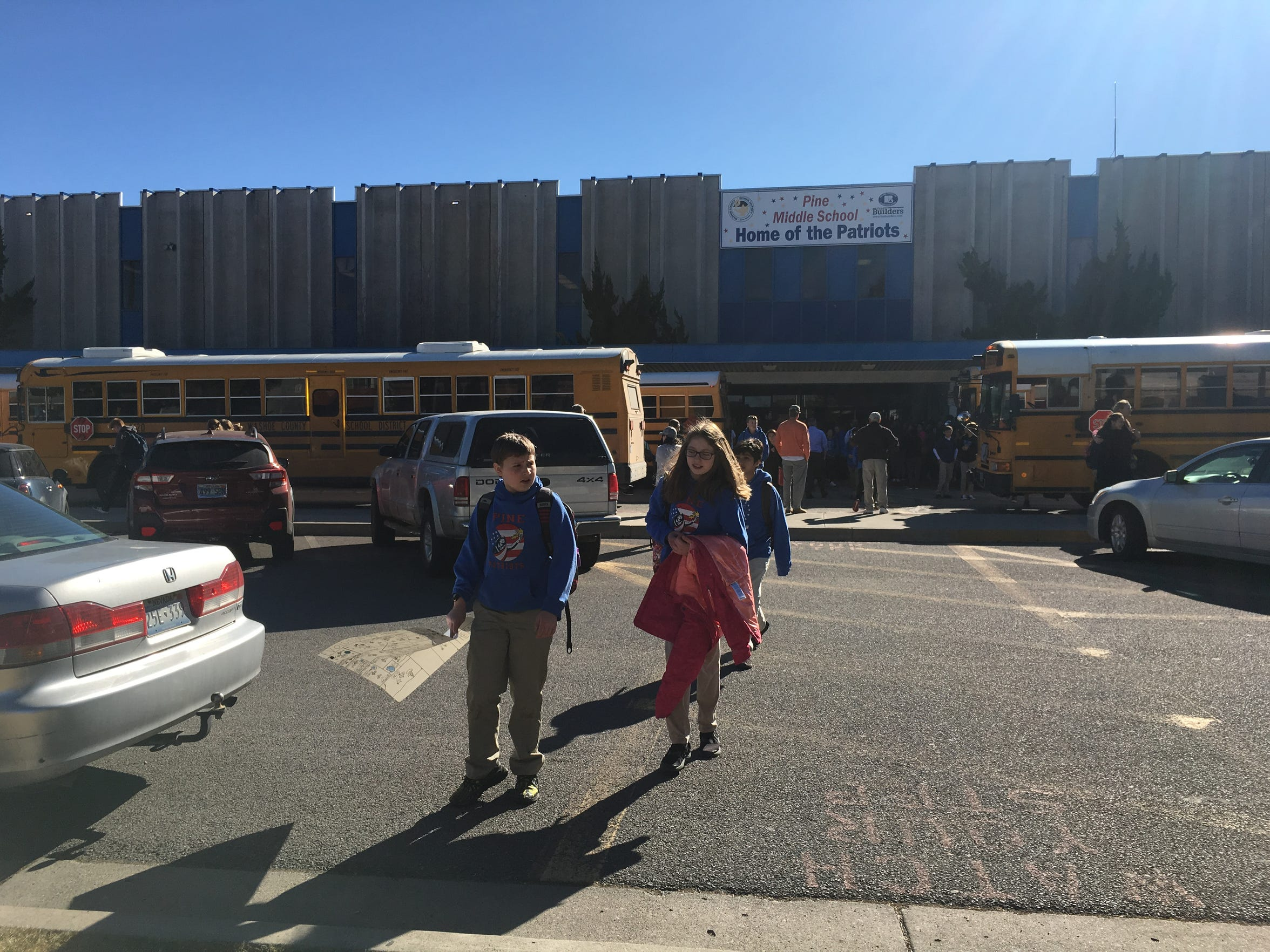 Students leave Pine MIddle School after a code red lockdown on Feb. 15, 2018.
