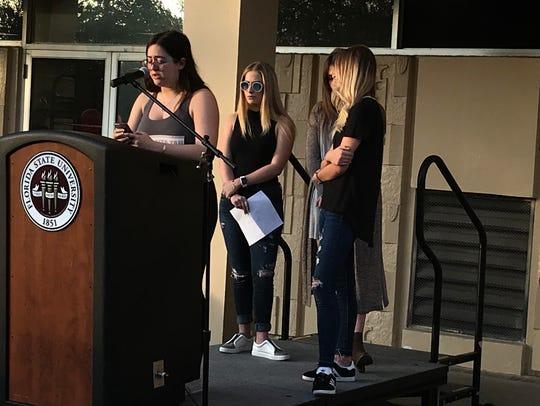Sigma Delta Tau sorority sisters prepare speak at vigil