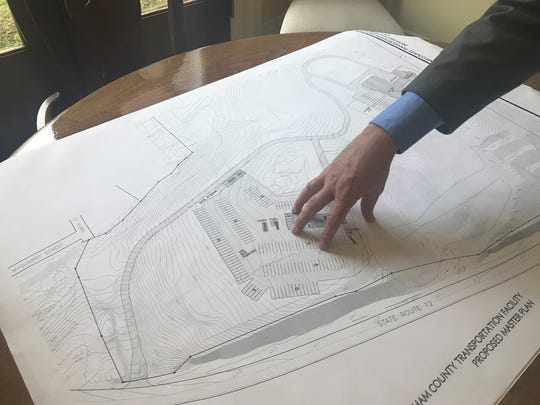 Cheatham County Mayor Kerry McCarver reviews plans for a proposed Criminal Justice Center as well as a new highway department and bus garage at Leeland Station in Ashland City.