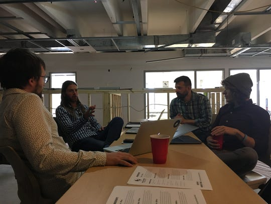 From left, Rise & Grind manager Kevin McGillivray, partner Garrit Bader, partner Eric Jandrain and Sandcastle co-founder Foster Douglas meet in Rise & Grind's main co-working space on the third floor of the Brown County Library.