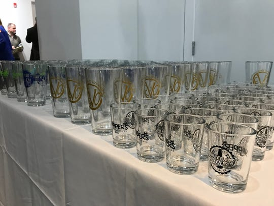 Beer glasses wait for drinkers at the Salisbury Area Chamber of Commerce Craft Beer Tasting at the Salisbury University Art Galleries on Feb. 15 2018.