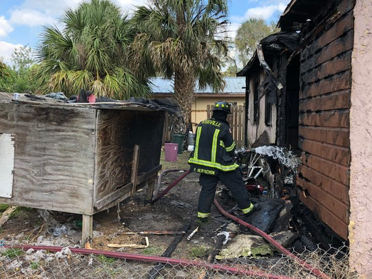 Titusville and Brevard County firefighters responded to a house fire on Lucky Street Friday. Firefighters were able to remove a dog from a wooden kennel in the back yard before the flames reached it.