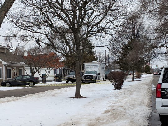 Police block streets to a home Feb. 16, 2018 on the