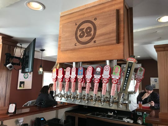 The new tap tower at Lock 32 Brewing in Pittsford features draft lines that descend through the ceiling.