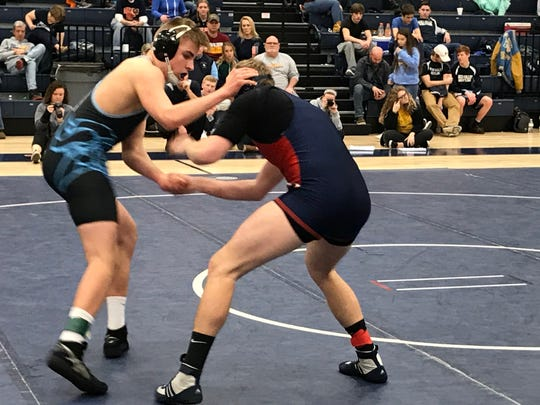 River Valley's Cooper Graham, left, wrestles Galion's Noah Grochowalski for the 182-pound championship at the Mid Ohio Athletic Conference Tournament Saturday at Galion.