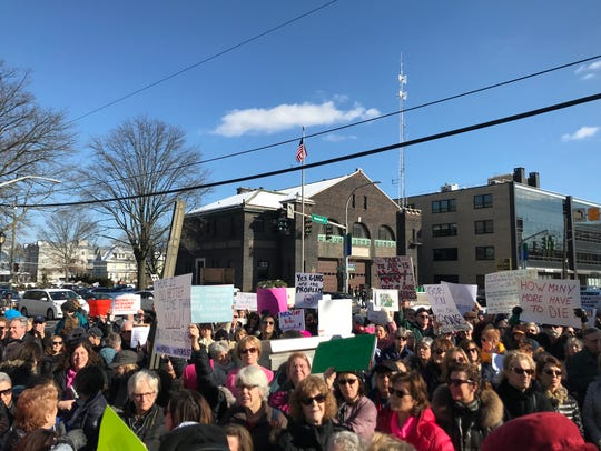 Hundreds of protesters gathered in front of the Westchester
