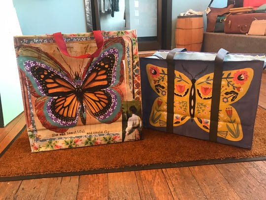These brightly colored bags are adorned with a butterfly