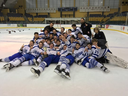 The Millburn Millers celebrate winning the Kelly Cup for the first time in program history.