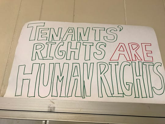 Protest sign in the hallway at 447 Thurston Road.