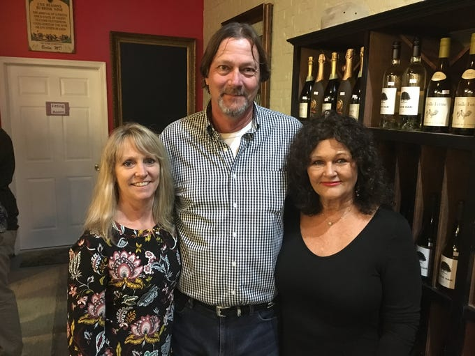 Donna Compher, left, owner of Sisters Mike and Deborah
