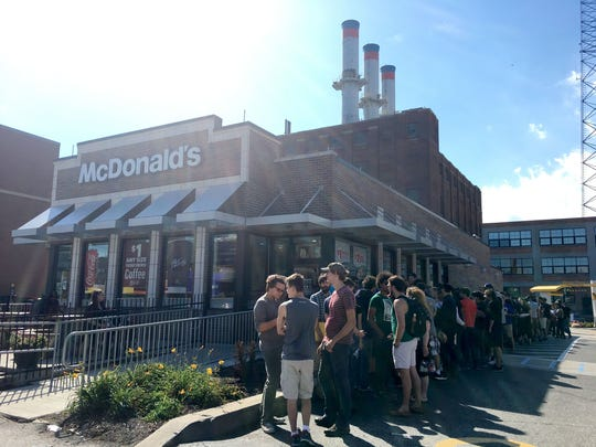 A crowd gathers outside the McDonald's on Woodward near Canfield in Midtown Detroit awaiting the release of the limited-edition Szechuan sauce on Oct. 7, 2017.