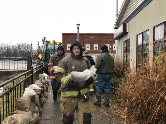 Firefighters and police in Eaton Rapids placed three