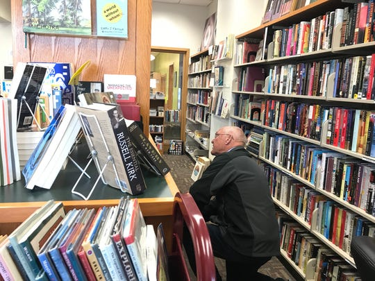 """Larry Olsen of DeWitt shops for books Feb. 21, 2018 at """"Marsha's Friendshop,"""" the used book sales effort that funds programs at the East Lansing Public Library."""
