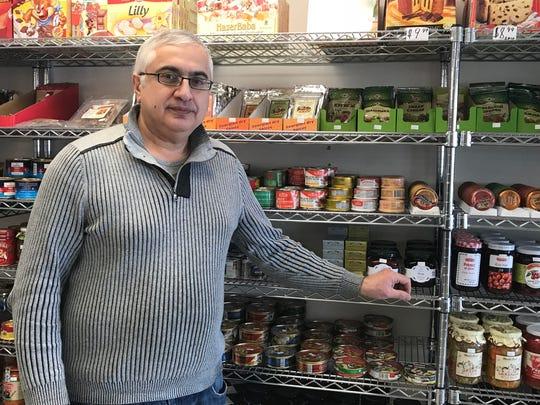 Igor Avetisov, owner of Beryozka Grocery, poses in