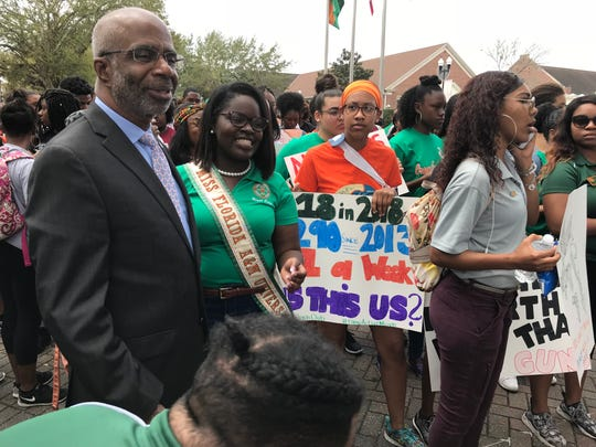 Florida A&M University President Larry Robinson, left. joins students in marching from Lee Hall to the Capitol on Wednesday, Feb. 21, 2018.