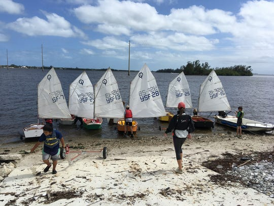 Young Opti sailors get their boats rigged and ready