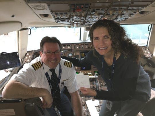 Captain Jim Moorey, who flew Brit Morin's wedding ring back to her, is pictured with EWR Customer Service Managing Director Cathy Innocenti, who called Morin when the ring was found.