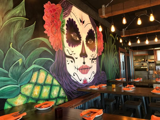 A colorful mural is painted on a wall at La Pina, a new modern Mexican restaurant near Chadds Ford, Pa.