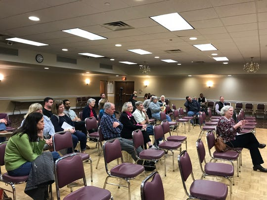 A couple of dozen Verona residents attend a forum on Feb. 21, 2018, explaining the township's revaluation process