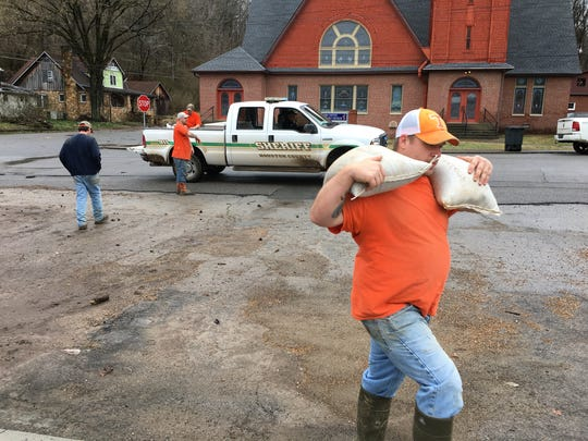Work crews from the Houston County Jail filled and distributed sandbags to businesses in the downtown area of Erin.