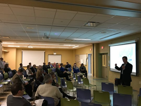 Mark Beauchamp presents his company's concepts for the Turtle Back Zoo in West Orange on Feb. 22, 2018.