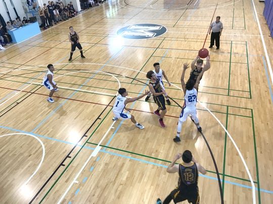 The St. Paul Warriors prepare to trap a Grace International player during their game in the Asian Christian Conference Schools' Boys' Basketball Tournament at the Morrison Christian Academy Campus in Taichung City, Taiwan. The Warriors won 64-61 .