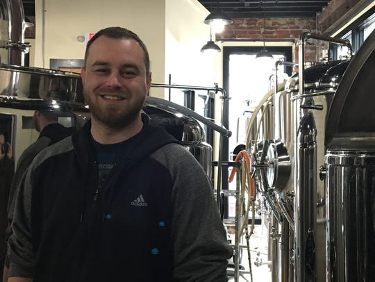 Dan Benfer stands in front of the fermenting tanks at Raritan Bay Brewing in Keansburg.