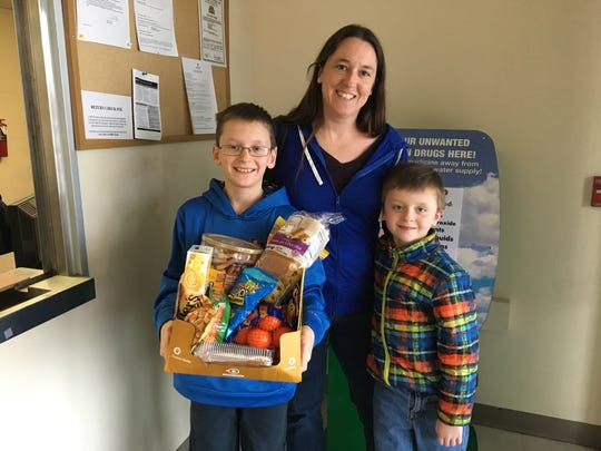 Erin Strutt, center, with her boys, Owen, 10, and Colin,