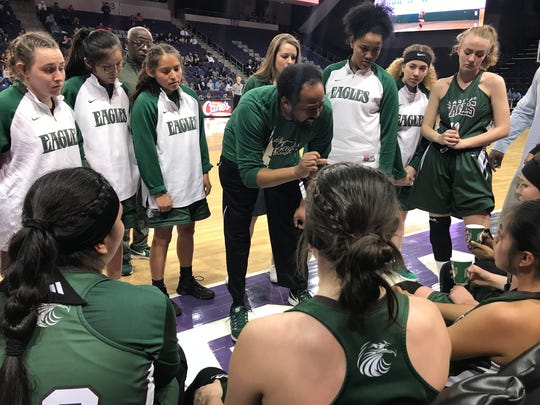 Flagstaff head coach Tyrone Johnson talks to his team during a timeout against Pueblo.