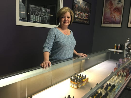 Stacey Hamilton poses in her newly-reopened store Kaleidoscope
