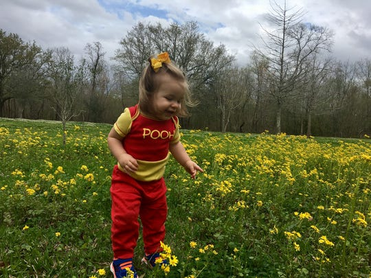Marie Guidry, 1, checks out flowers at St. Bernard State Park.