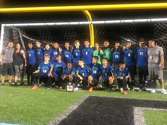 The East Naples Middle School boys soccer team recently won the Collier County championship, its first title in 50 years and possibly ever. Top row, left to right: Assistant coach Luis Nicacio, assistant coach Vanessa Wingo, Gael Garcia, Matthew Velez, Roberto Olivos, Emiliano Nicacio, Mark Benitez, Colton Castillo, Jonathan Nicacio, Diego Diaz, Zahir Gonzalez, Andrew Santiago, Ubaldo Martinez, Ehivy Ramos, head coach Jorge Cruz. Bottom row, left to right: Oliver Ditheridge, Enrique Rodriguez, Omarion Boston, Hector Avendano, Giovanni Ramos, Eder Alonso and Alvin Arreguin.