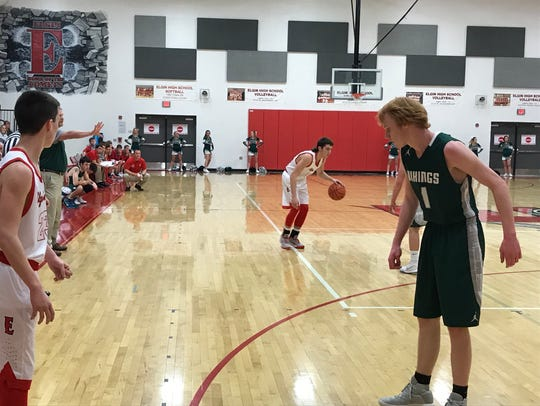 Elgin senior Tyler Nichols dribbles the ball as teammate