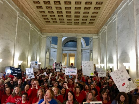 West Virginia teachers on strike at the state Capitol in Charleston, W.Va.