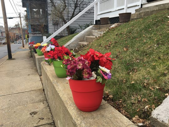 Faux flowers line West Beverley Street in honor of