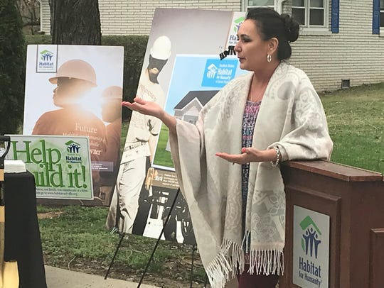Megan Cranford, wife of late Cheatham County Mayor David McCullough, speaks at a Cheatham Habitat for Humanity ceremony dedicating land to her husband.