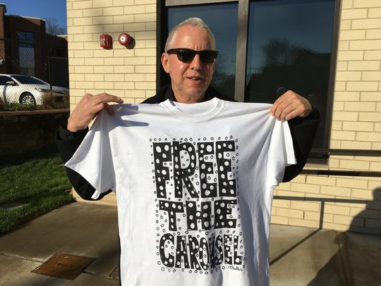 "Nashville artist Myles Maillie with the ""Free the Carousel"" T-shirt and protest he designed to resurrect Red Grooms' famed Tennesseee Fox Trot Carousel"