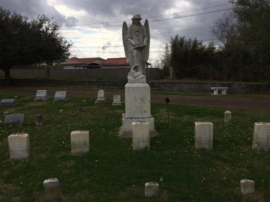 """The """"Turning Angel"""" monument in the Natchez City Cemetery stands guard over five gravesites of young people who died in an explosion at Natchez Drug Company in 1908. Over the years, folks have reported the angel """"turning"""" to look at them as they passed by. It didn't happen for this reporter."""