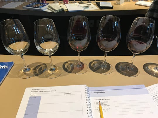 Notebooks are opened and wines are lined up for tastings at a WSET class at the New York Wine and Culinary Center in Canandaigua.