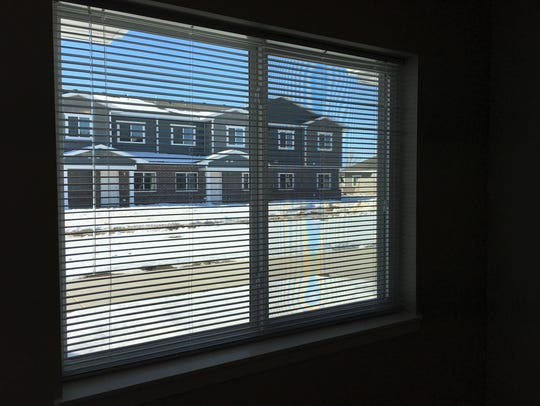 A look through a Trinity Point apartment window toward