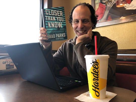 Author Brad Parks writes his books at the Staunton