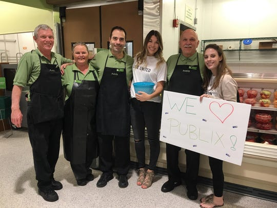 Sydney Mihailoff, Caitlin Puppo, with Publix employees.