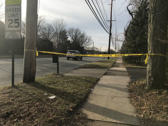 Police tape marks a portion of Valley Road in Wayne where an woman and child were hit by a car Tuesday night. The woman died, and the child was seriously injured.