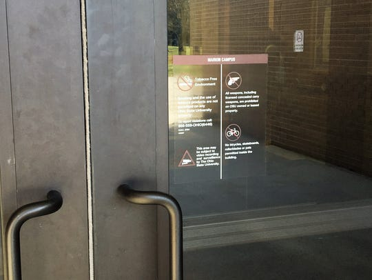 A sign is posted on a building at The Ohio State University's Marion campus stating that the campus is a gun free zone.