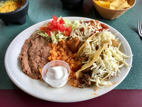 The trio plate at Gutierrez Restaurant comes with one soft taco, one hard taco and a red taco, filled with choice of chicken, shredded beef or pork in each.