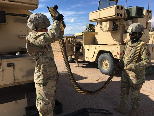 Soldiers from Charlie Battery, 5-5 ADA handle .50 caliber ammunition for the machine gun that is part of the Avenger system. Air defense soldiers from Fort Sill, Fort Hood and Fort Bliss participated in the Roving Sands exercise.