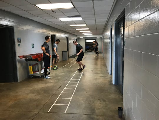 The Ice Flyers work out in the hallway Thursday  while