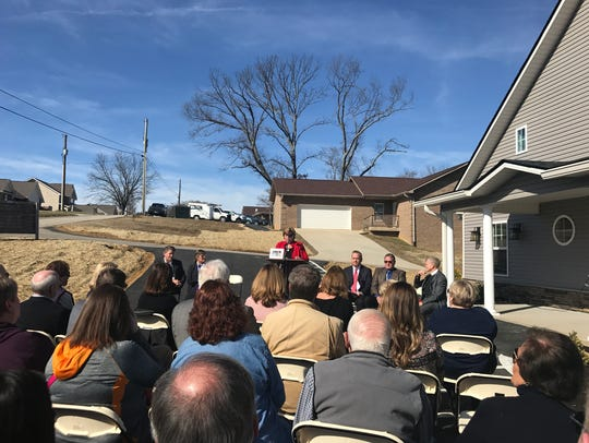 Jan McCoy speaks at the Feb. 9 ribbon-cutting for a
