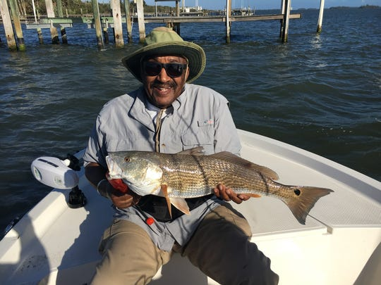 "JD topped of the morning with this 27"" redfish that had a belly full of lures."